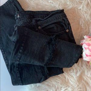 Skinny distressed black jeans